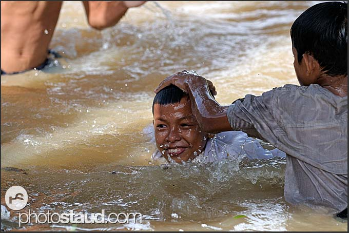 Cambodian children playing in Siem Reap river, Cambodia