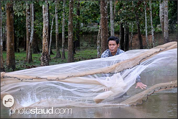 Fisherman casting net, Cambodia