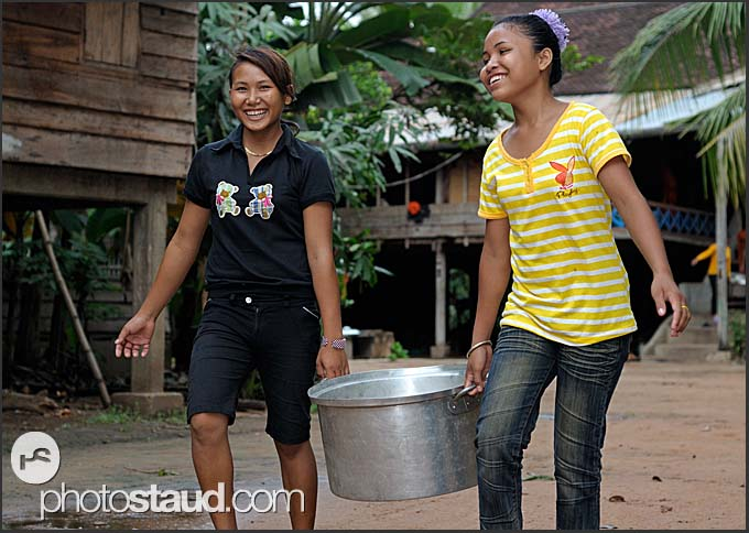 Cambodian girls carrying dishes, Cambodia