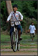 Boy riding bike, Cambodia