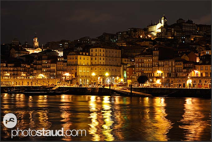 Ribeira quayside by night viewed across the Douro River, Porto, Portugal