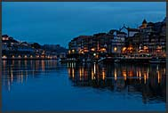 Douro River winding through Porto by night, Portugal