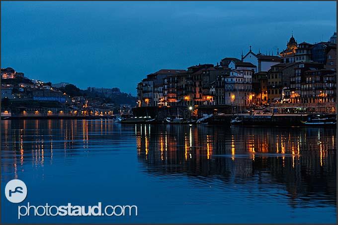 Douro River winding through Porto by night, Portugal