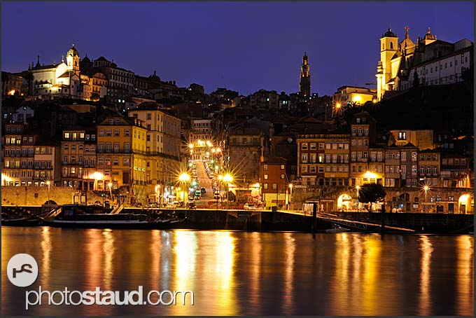 Porto cathedrals in Ribeira district reflecting in Douro River, Porto by night, Portugal