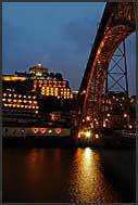 Ponte de Dom Luis I bridge across the Douro River illuminated by night, Porto, Portugal