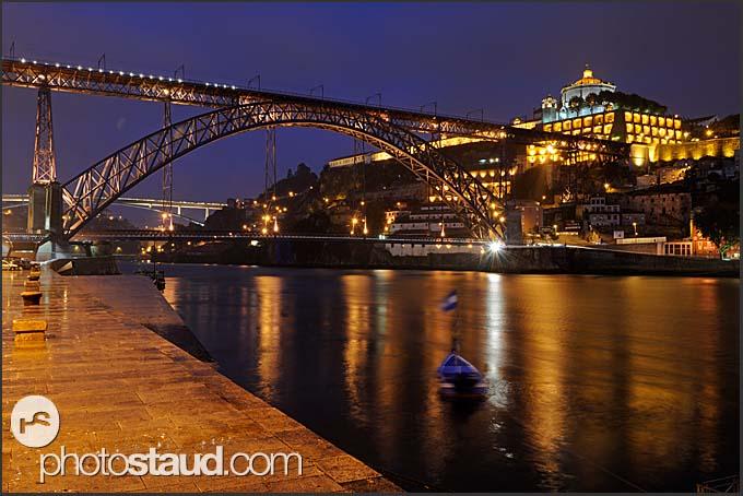 Ribeira quayside with Ponte de Dom Luis I bridge and Mosteiro da Serra do Pilar illuminated by night, Porto, Portugal