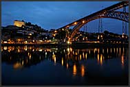 Ribeira quayside by night reflecting in the Douro River, Porto, Portugal