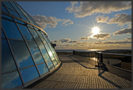Sunset observed from Perlan, landmark building atop water tanks with natural hot water, Reykjavik, Iceland