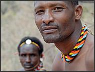 Samburu warriors wearing traditional bead ornaments in the Nyiru Mountains, Kenya