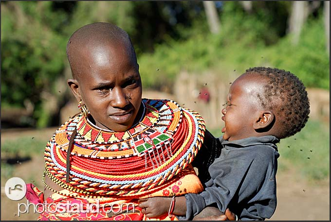 Mother, flies and crying child - Samburu people of the Nyiru Mountains, Northern Kenya