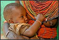 Samburu mother with little child in her arms, Kenya
