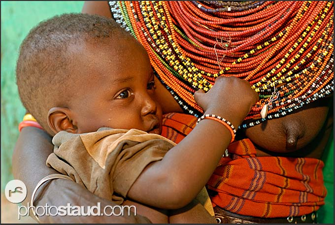 Samburu mother with little child in her arms, South Horr, Kenya