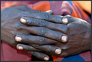Close up of connected fingers of Samburu woman, Kenya