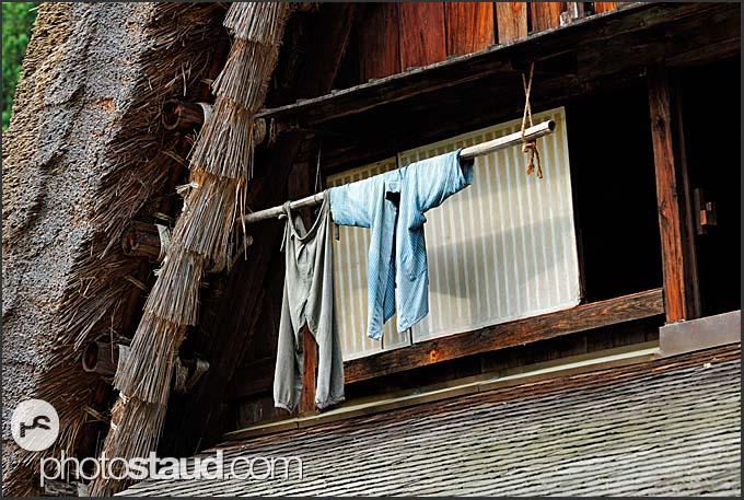 Landry hanging on gassho zukuri farm house, Shirakawa village, UNESCO World Heritage site, Japan