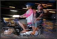Cambodian woman riding motorbike, Siem Reap, Cambodia