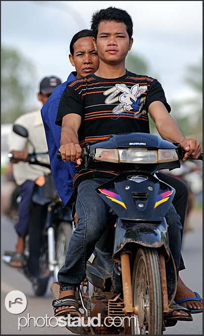 Cambodian boys riding motorbike, Siem Reap, Cambodia