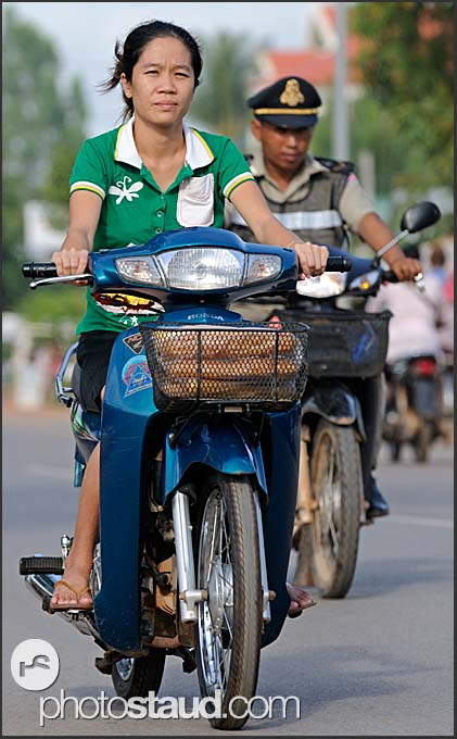 Woman and policeman in the streets of Siem Reap, Cambodia
