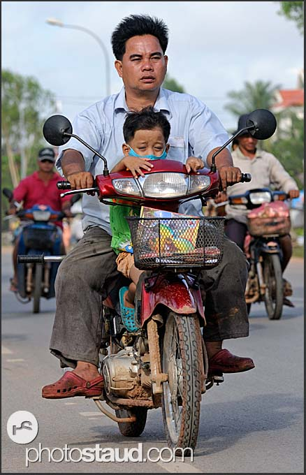 Father and son riding motorbike, Siem Reap, Cambodia