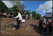Cyclists in the flooded streets of Siem Reap, Cambodia