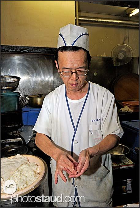 Japanese chef making sushi in Japanese sushi bar, Sendai, Japan