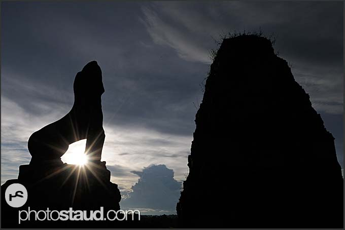 Statue of roaring lion silhouetted against setting sun, Ta Keo Temple, Angkor, Cambodia
