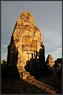 Ta Keo Temple of Angkor reflected in water at dusk, Cambodia