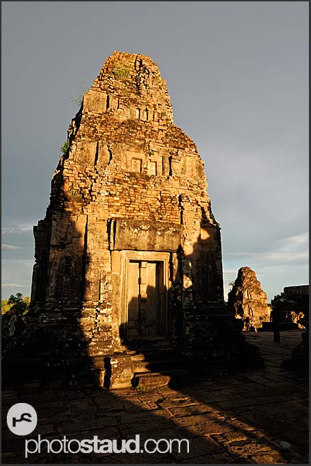 Stone tower of Ta Keo Temple lit by setting sun, Angkor, Cambodia