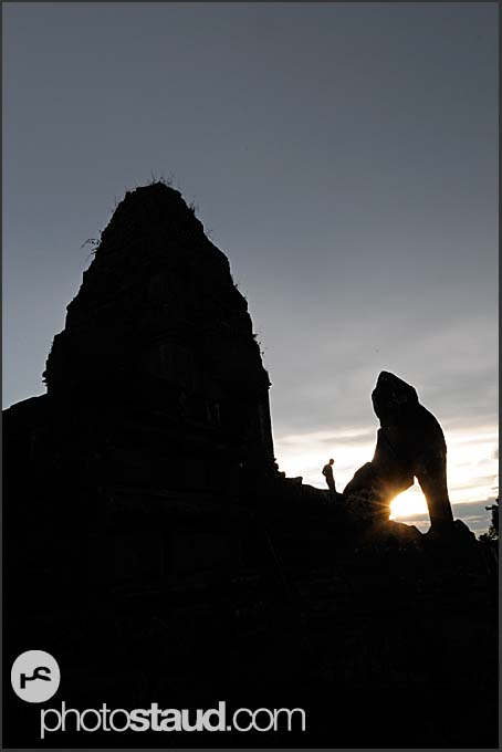 Roaring lion silhouetted against setting sun, Ta Keo Temple, Angkor, Cambodia