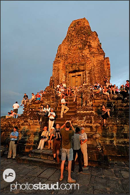 Tourists gathering at Ta Keo Temple to watch sunset, Angkor, Cambodia