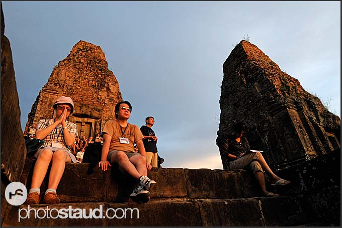 Tourists watching sunset from Ta Keo Temple, Angkor, Cambodia