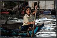 Little boy holding snake, Tonle Sap Lake, Cambodia