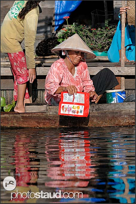 People in a floating village on Tonle Sap Lake, Cambodia