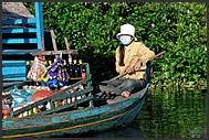 Boat vendor on Tonle Sap Lake, Cambodia