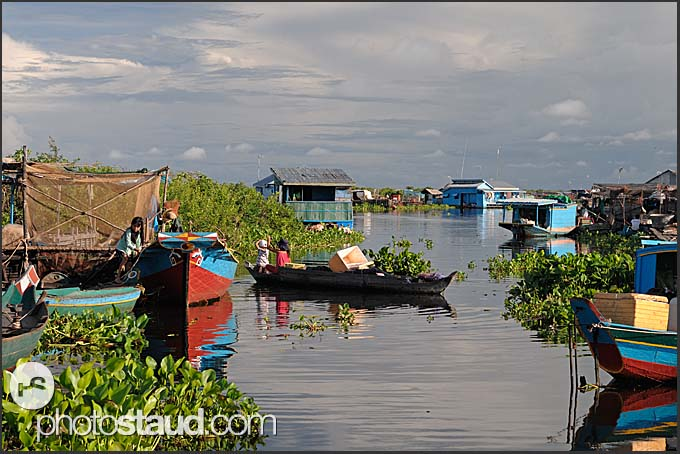 Houses and boats in a floating village on Tonle Sap Lake, Cambodia
