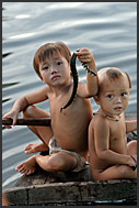 Little boys holding snakes, Tonle Sap Lake, Cambodia