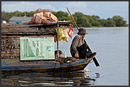 Man on a boat, Tonle Sap Lake, Cambodia