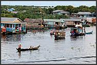 Man sitting on vending boat, Tonle Sap Lake, Cambodia