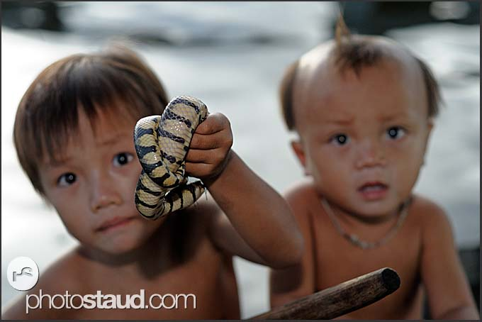Little boys holding snakes, Tonle Sap Lake, Cambodia