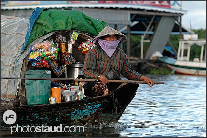 Woman transporting goods on a shopping boat, Tonle Sap Lake, Cambodia