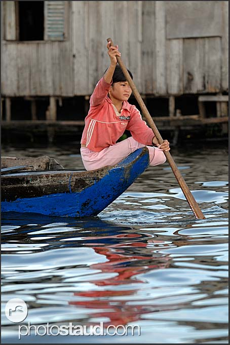 Little girl paddling on Tonle Sap Lake, Cambodia