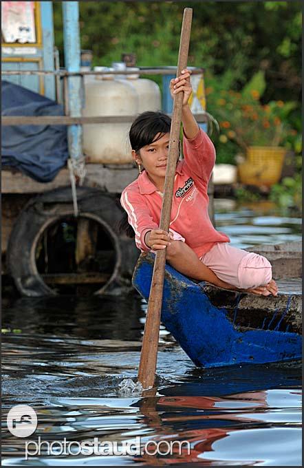Little girl paddling on Tonle Sap Lake, Cambodia