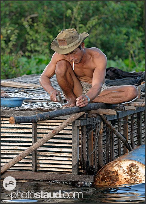 Building floating house on Tonle Sap Lake, Cambodia