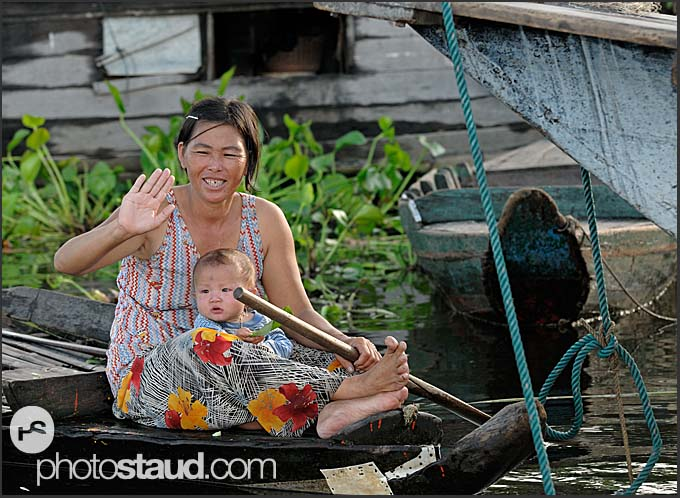 Mother and boy on Tonle Sap Lake, Cambodia