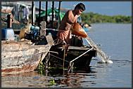 Mother washing up in Tonle Sap Lake, Cambodia