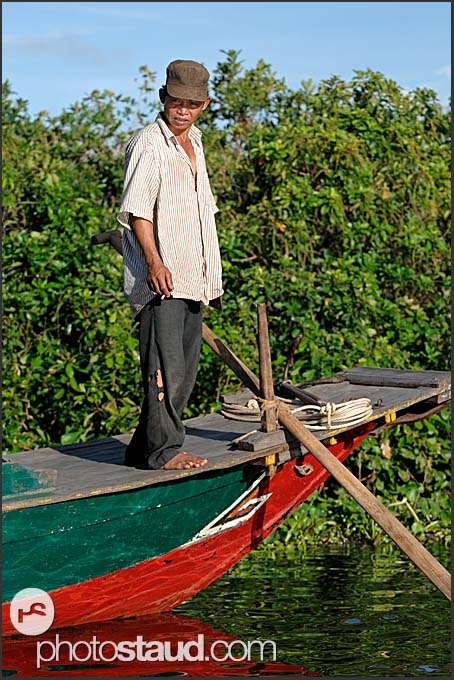 Man on a boat, Tonle Sap Lake, Cambodia