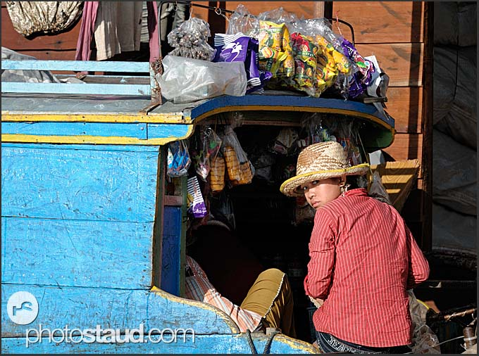 Young girl on a shopping-boat, Tonle Sap Lake, Cambodia