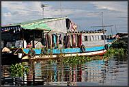 Houseboat in floating village of Tonle Sap Lake, Cambodia