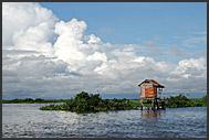 Fisherman on a boat, Tonle Sap Lake, Cambodia