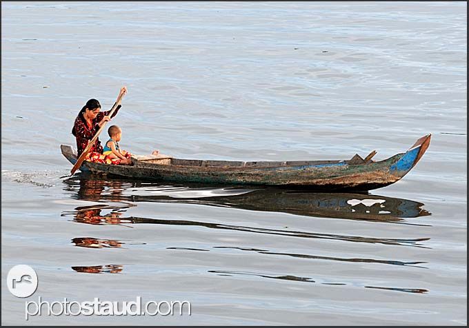 Mother and son paddling on Tonle Sap Lake, Cambodia