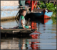 Little boy on a boat, floating village, Tonle Sap Lake, Cambodia